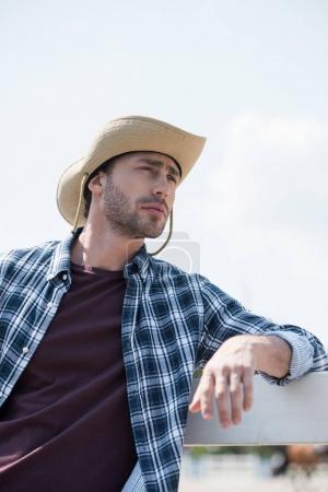 handsome man in cowboy hat