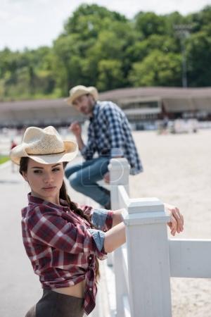 Attractive woman in cowboy hat
