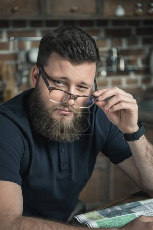 pensive man in eyeglasses