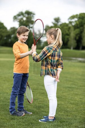 siblings playing badminton
