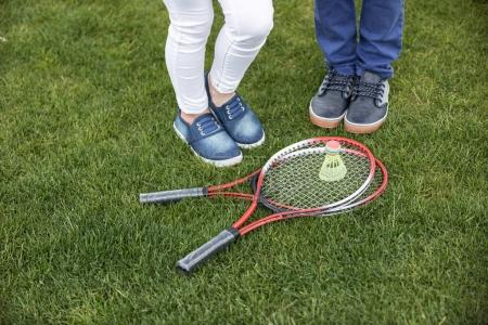 children standing near badminton equipment
