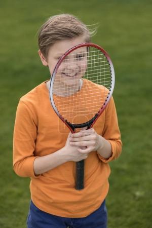 Boy with badminton racquet