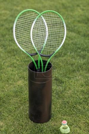 Badminton racquets in container