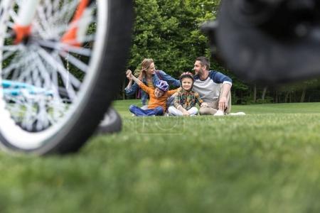 Happy family spending time in park