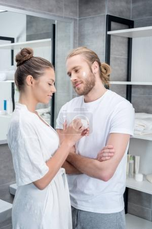 couple applying face cream
