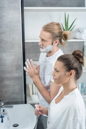 young couple in bathroom in the morning