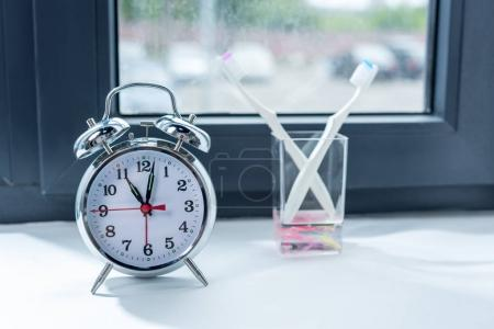 Alarm clock and toothbrushes in glass 3