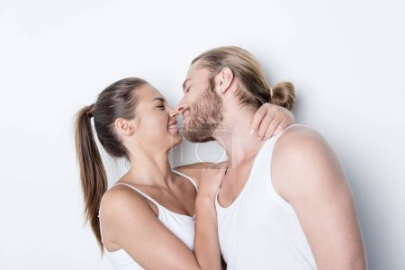 Woman going to kiss husband