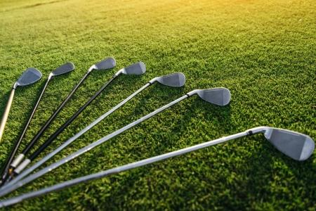 Golf clubs on grass