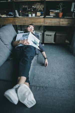 Man sleeping with newspaper