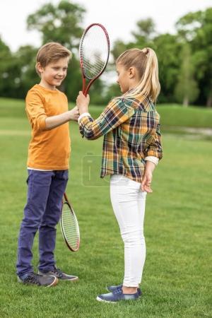 siblings playing badminton
