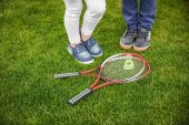 Children with badminton equipment