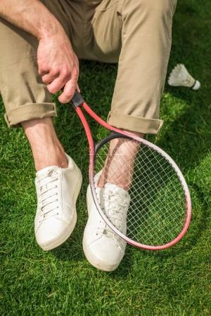 man with badminton racket