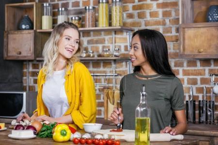 Multiethnic women cooking