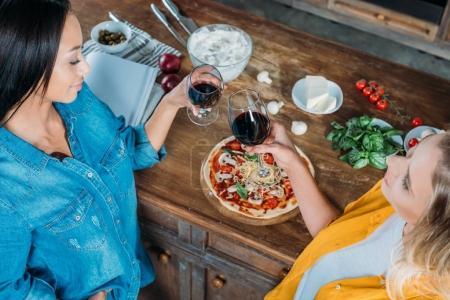 Multiethnic women in kitchen
