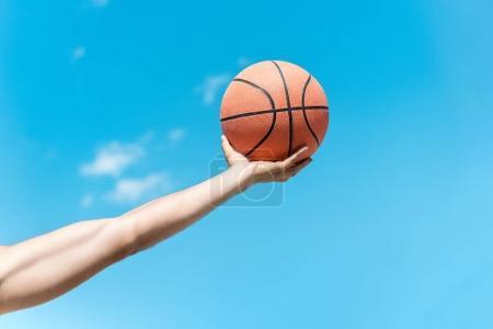 hand with basketball ball