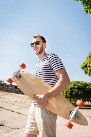 Man holding skateboard