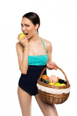 woman in swimsuit with fruits