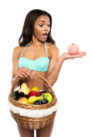 Shocked woman with peach