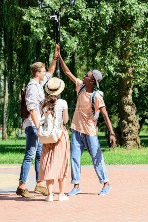 multiethnic men giving high five