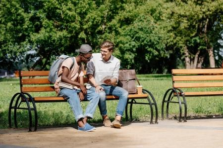 multicultural students studying in park