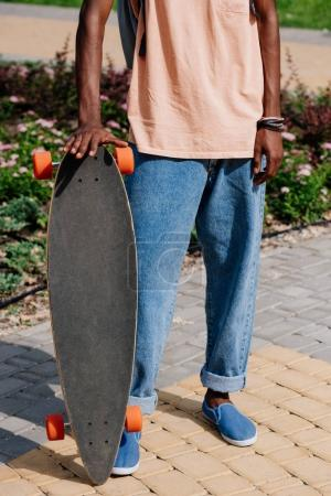 man holding longboard