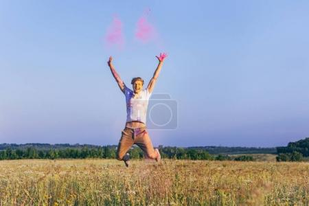 man jumping at holi festival