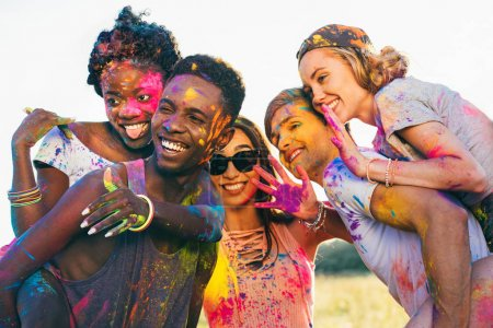 Multicultural friends at holi festival