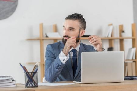 businessman at workplace with laptop