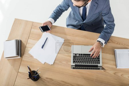 Businessman working on laptop at workplace