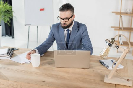 businessman with coffee cup at workplace