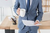 businessman with coffee cup and papers