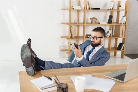 businessman listening music at workplace