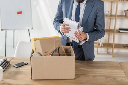 Fired businessman packing things