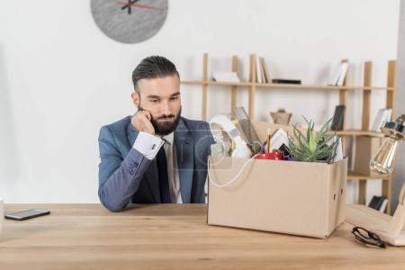 fired upset businessman at workplace