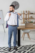 smiling businessman quitting job