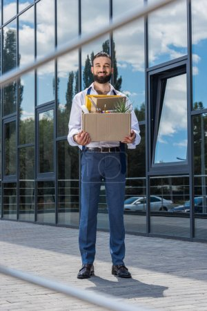 fired happy businessman with box
