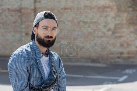 stylish hipster man on street