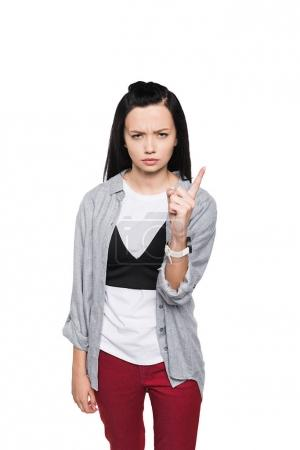 Serious girl pointing with finger