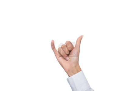 Photo pour Vue recadrée de personne gesticulant signé langue, isolé sur blanc - image libre de droit