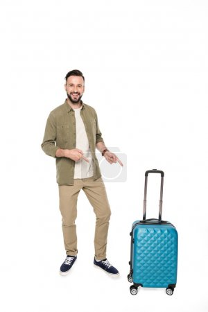man pointing at suitcase