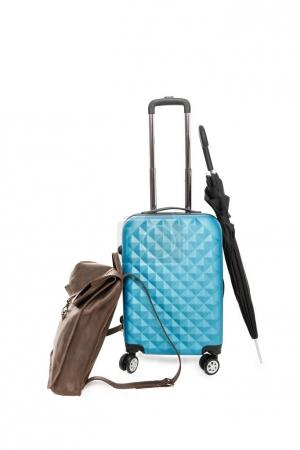blue suitcase, umbrella and bag