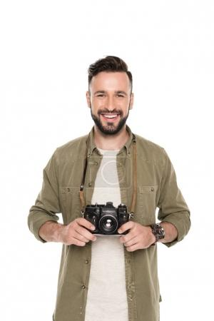 Smiling man with photo camera
