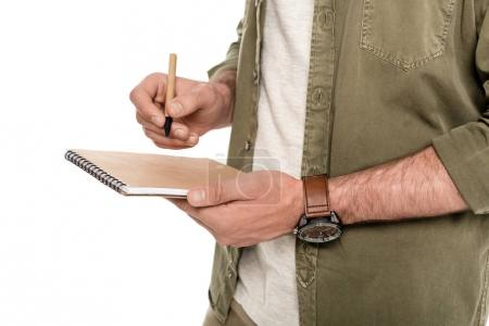 Man with notebook and pen in hands