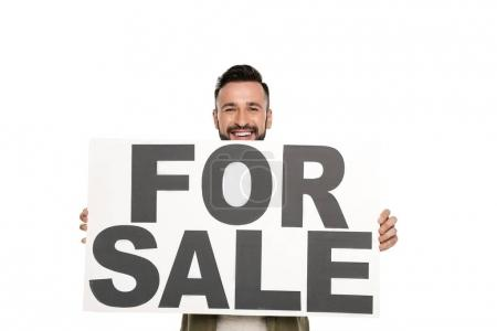 Man with for sale banner