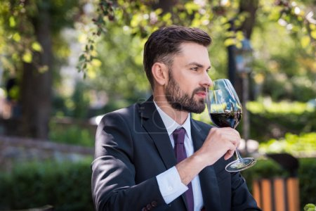 caucasian man with wine in restaurant