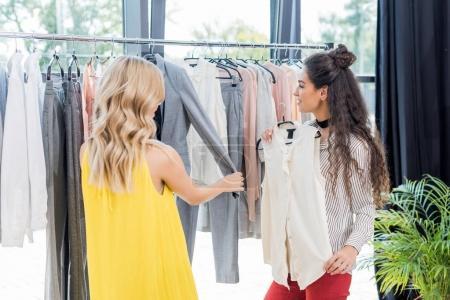 women choosing clothes in showroom