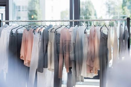 Photo for Rack with hanging clothes in store - Royalty Free Image