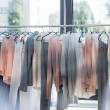 Rack with hanging clothes in store...
