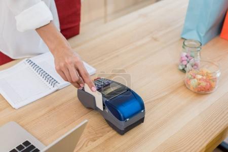 Woman using pos terminal